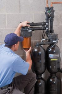 Westfair Service Technician Inspecting Softener